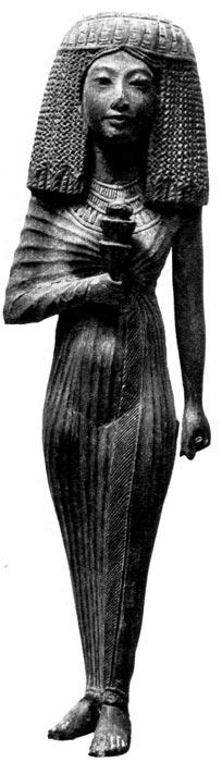 34. Ханонтон. Деревянная фигурка, XIX династия. Египетский музей, Каир. Знатная женщина с высоким париком, одета в каласирис из мягкой шелковой ткани.