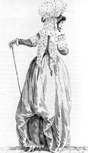 326. Из французского модного журнала. Молодая дама с подобранной юбкой, рукавами аль эспаньоль (a I'espagnole) и тюрбаном дамур (d'amour).